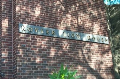 Close up of sign in front of the Kovler Lion House. image. Click for full size.
