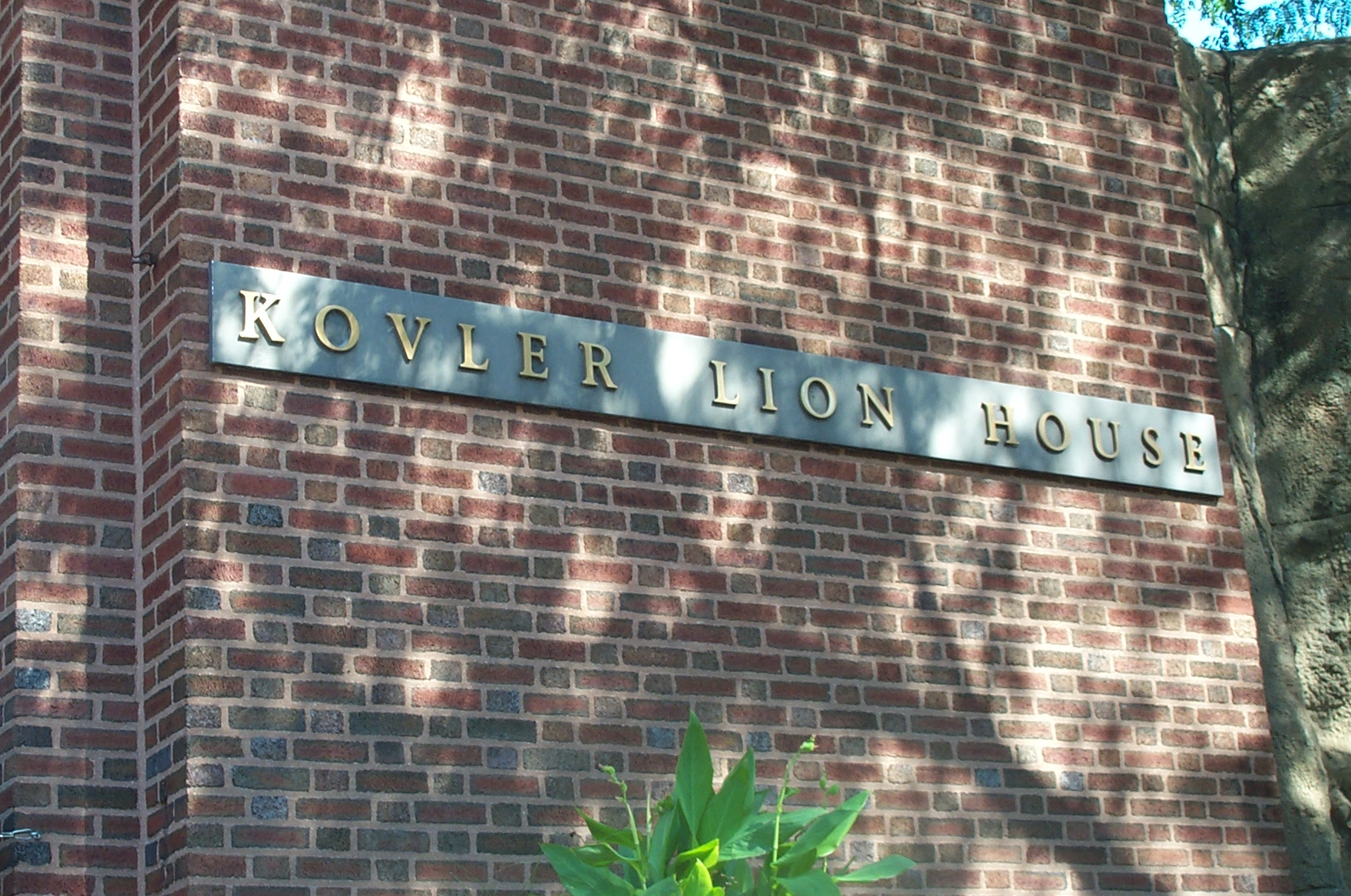 Close up of sign in front of the Kovler Lion House.
