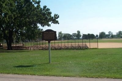 Potter's Field Marker with baseball fields in the background. image. Click for full size.