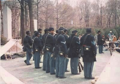 Reenactors representing the 1st U.S. Colored Infantry Regiment meet and greet the public, 1992 image. Click for full size.
