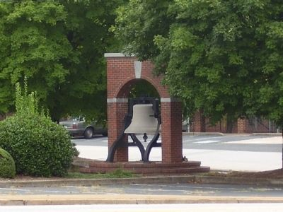 Bell across the road from the District Five War Memorial Marker image. Click for full size.