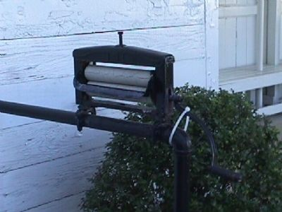 Wringer for laundry - Mounted on the railing outside the kitchen area. image. Click for full size.