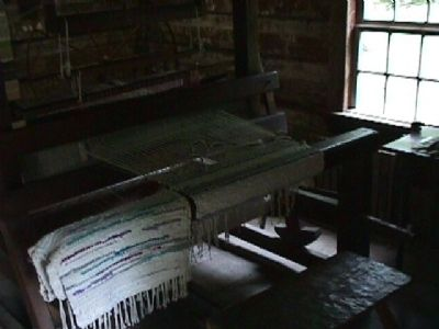 Weave loom exhibit image. Click for full size.