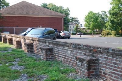 The remaining brick wall on the western side of the park. image. Click for full size.
