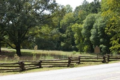 Peachtree Trail Marker (at right) in a field at the Kennesaw Mountain National Battlefield image. Click for full size.