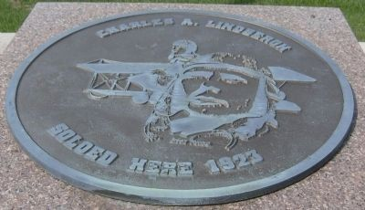 Bronze Disk atop the Memorial image. Click for full size.