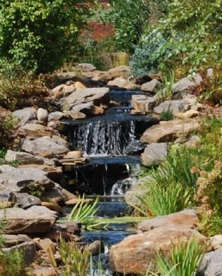 Waterfall in the Interpretive Gardens Around the Museum image. Click for full size.