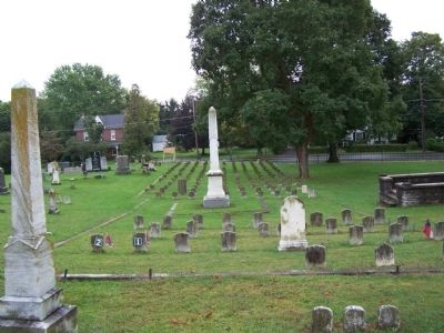 Obelisk and 114 Confederate grave stones. image. Click for full size.