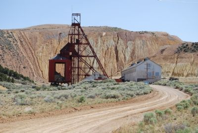 Old mine headframe and ore processing plant image. Click for full size.