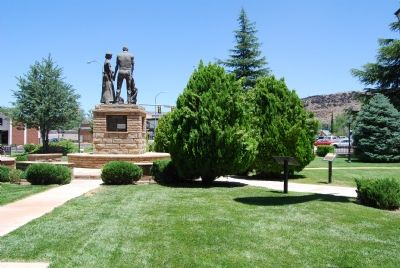 Statue of pioneers in the park. Marker is on base of statue. image. Click for full size.