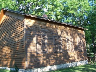 Side of the school house. image. Click for full size.