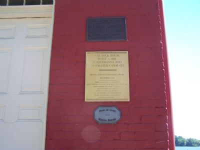Plaques at entrance to Lock House image. Click for full size.