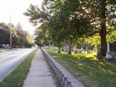 Looking down the street at the marker and cemetery image. Click for full size.