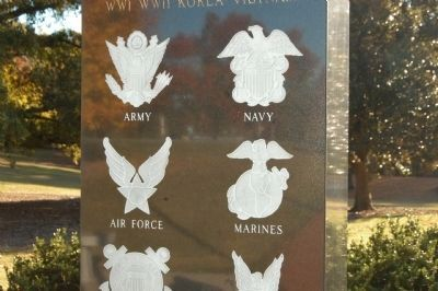Seals from four of the DoD services on the Spartanburg County War Memorial image. Click for full size.