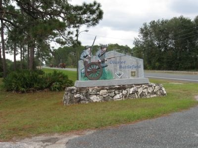 The Battle of Olustee State Park sign - note lumber trucks in background image. Click for full size.