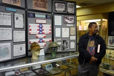 Capt. Paul J. Matthews explaining Camp Logan exhibit, Buffalo Soldiers National Museum image. Click for full size.