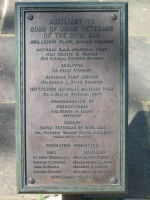 Dedication Plaque Behind the Monument image. Click for full size.