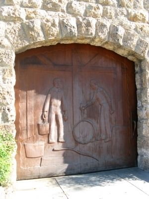 Carved Wooden Doors at Side Entrance to Winery Building image. Click for full size.