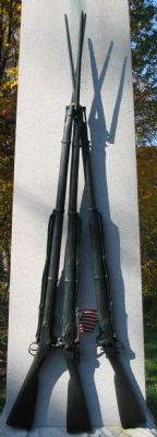 Stand of Rifles on Front of Monument image. Click for full size.