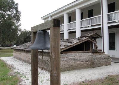 Gamble Mansion bell and cistern at the rear of the house image. Click for full size.