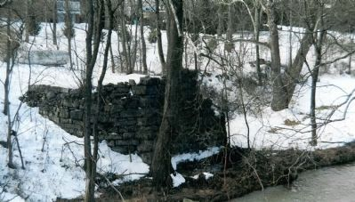 Remains of the Civil War era bridge abutment in the yard of the Palmer House image. Click for full size.