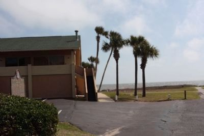 Captain Wylly Road Marker, at a motel parking lot with Atlantic Ocean in background image. Click for full size.