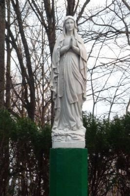 Replica of the statue of Our Lady in the Esplanade of the Lourdes Grotto in France image. Click for full size.