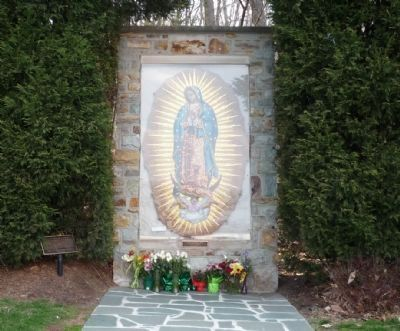 Shrine to Our Lady of Guadalpe, adjacent to the campanile image. Click for full size.