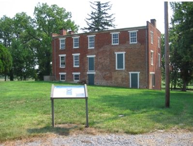 The Marker Stands between the Pritard House, in the Background, and Visitors Center image. Click for full size.
