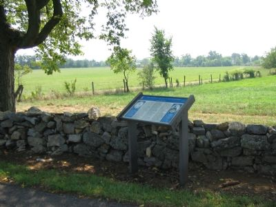 Marker Beside the Stone Wall image. Click for full size.