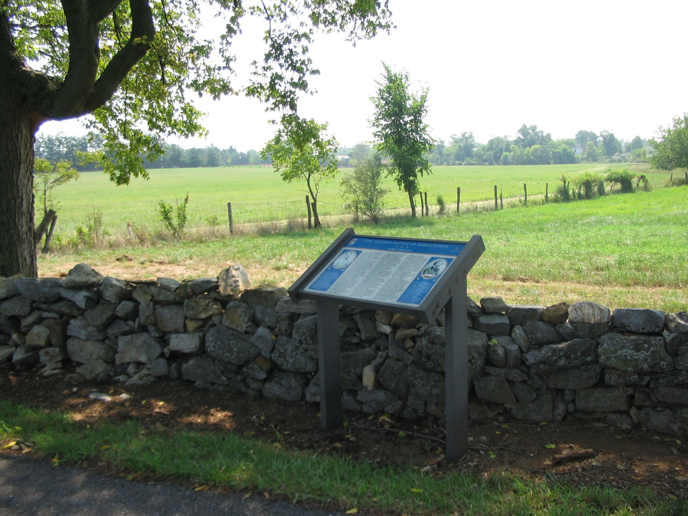 Marker Beside the Stone Wall