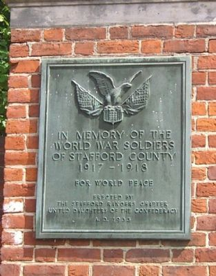 Plaque on Brickwork at Church Exit - Northside image. Click for full size.