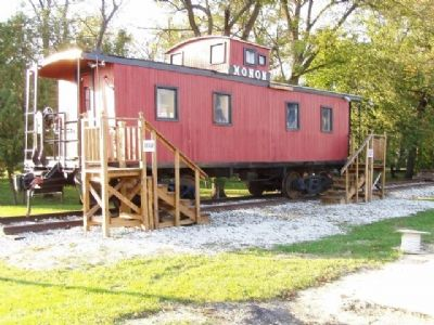 Monon Caboose in the park (site of Monon Station). image. Click for full size.