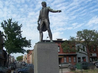 Statue of Captain John O'Donnell with dwellings in background image. Click for full size.