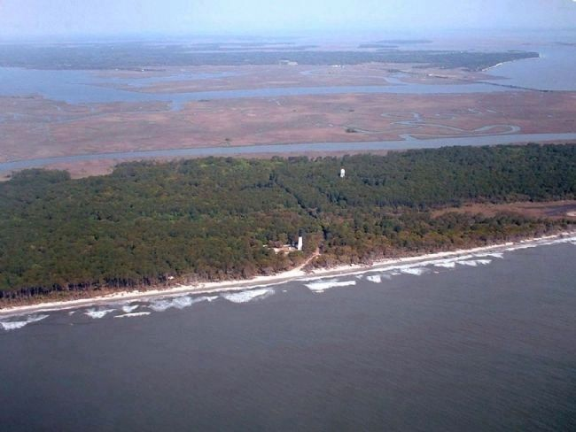 Hunting Island Light Station , seen from the air, Atlantic Ocean, looking west image. Click for full size.