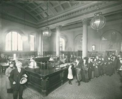 Patrons at the Check-out Desk of the Oakland Free Library, 1904 image. Click for full size.