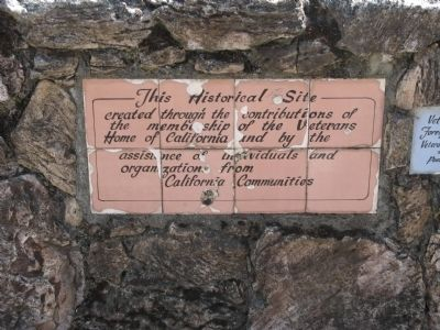 Plaque Mounted on Stone Wall at the Marker Location image. Click for full size.