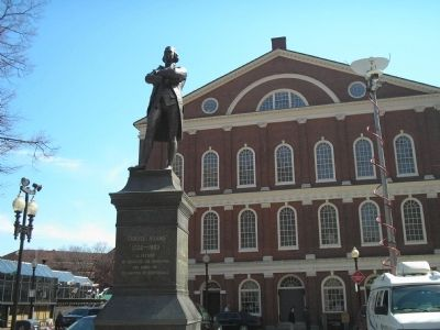 Samuel Adams in front of Faneuil Hall image. Click for full size.
