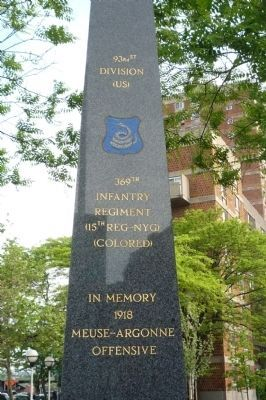 369th Infantry Regiment Memorial - close-up of north face inscriptions and rattlesnake insignia image. Click for full size.