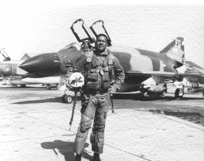 "Tuskegee Airman, then-Col. Daniel ""Chappie"" James and his F-4C Phantom II fighter plane image. Click for full size."