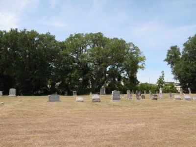 Wider view of the cemetery. Marker by tree center. image. Click for full size.