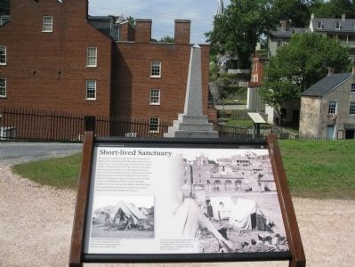 Short-lived Sanctuary Marker looking toward the John Brown Monument. image. Click for full size.