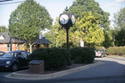 Plaque and clock. The Riverdale MARC station is in the background. image. Click for full size.