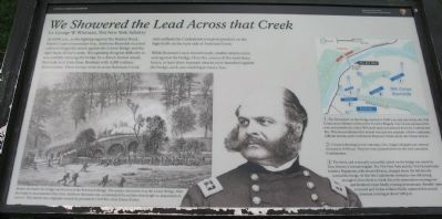 We Showered the Lead Across that Creek Marker image. Click for full size.