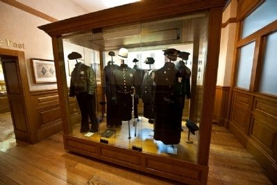 Display of historic NYC Police uniforms in the museum image. Click for full size.