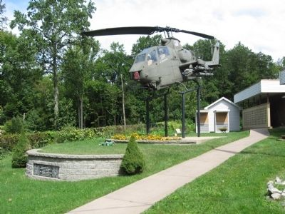 AH1G Huey Cobra Gunship above the stone wall with the marker image. Click for full size.