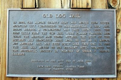 Old Log Jail Marker image. Click for full size.
