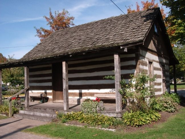 Visitors Center - - Log Cabin image. Click for full size.