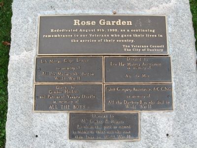 The plaques on the stone behind the flagpole image. Click for full size.