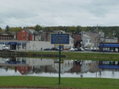 Downtown Monroe as seen looking past marker across the old Mill Pond. image. Click for full size.